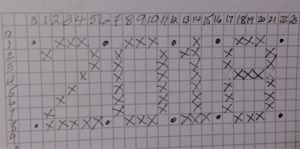 Lettering Chart on graph paper with numbers 2-0-1-8 planned on paper