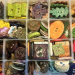 Buttons on display at the Nature Buttons vendor table, a selections of earth tones--greens, golds, browns, reds and more.